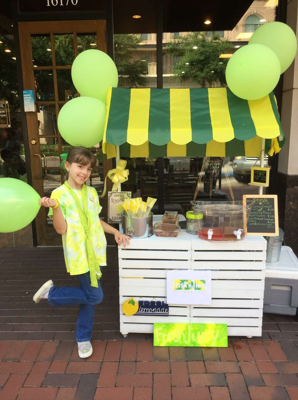 Sugar Land fourth grader Sabrina Roesler enjoys serving her special lemonade. She has been recognized as the Lemonade Day Houston 2020 Youth Entrepreneur of the Year.