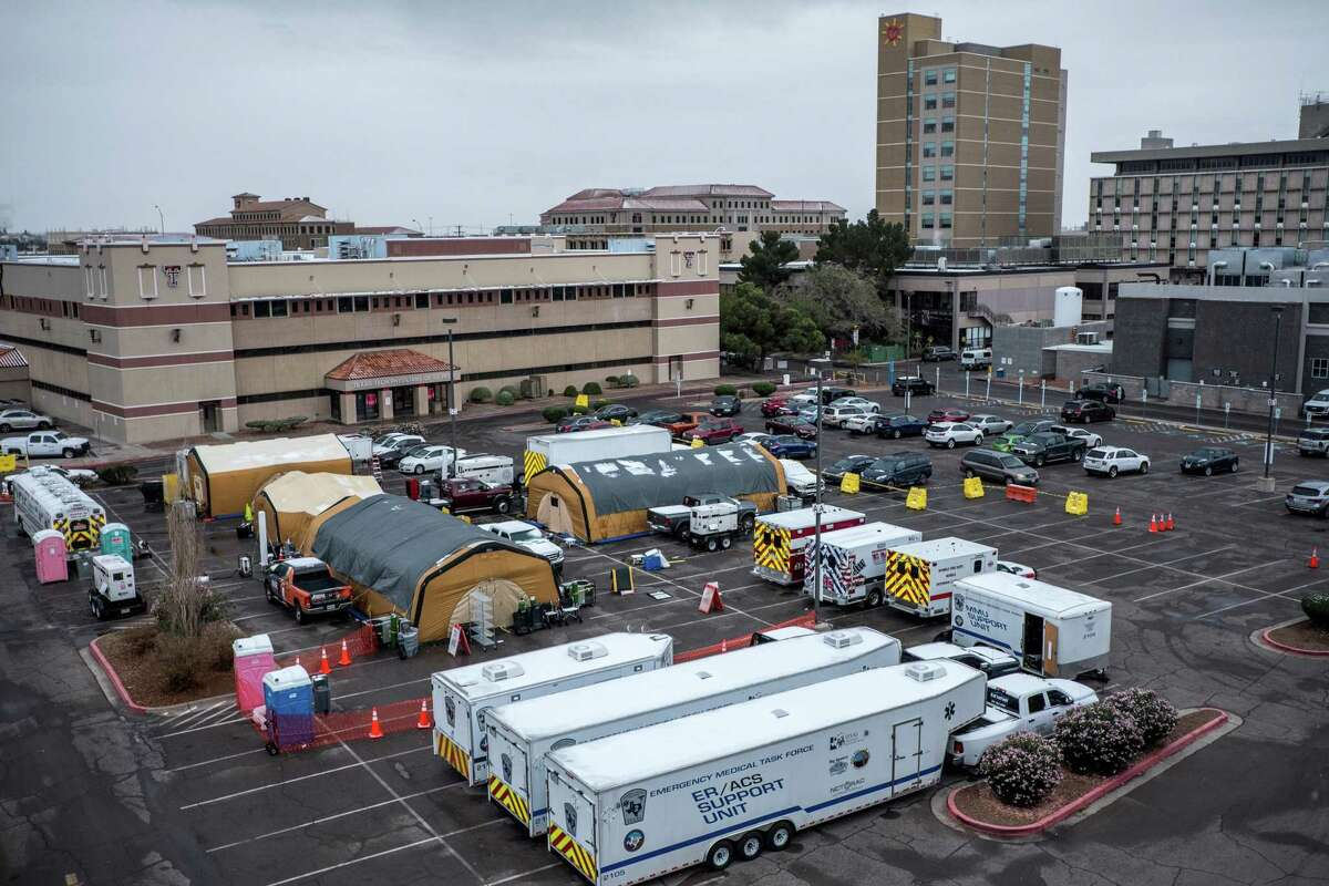 Recently-added tents are stationed at the Texas Tech University Health Sciences Center El Paso parking lot in El Paso on Tuesday. The number of people hospitalized with the coronavirus has climbed significantly from a month ago, straining cities that have fewer resources to weather the surges. (Joel Angel Juarez/The New York Times)