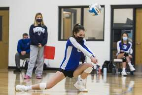 Gladwin's Renae Parrett bumps the ball in a match against Clare during a quad meet Wednesday, Oct. 28, 2020 at Meridian Early College High School. (Katy Kildee/kkildee@mdn.net)