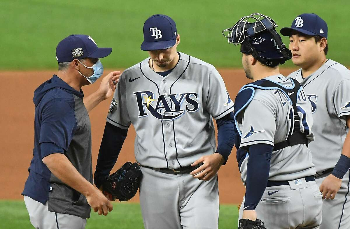 Rays manager Kevin Cash (left) removes pitcher Blake Snell during the sixth inning of Game 6 of the World Series.