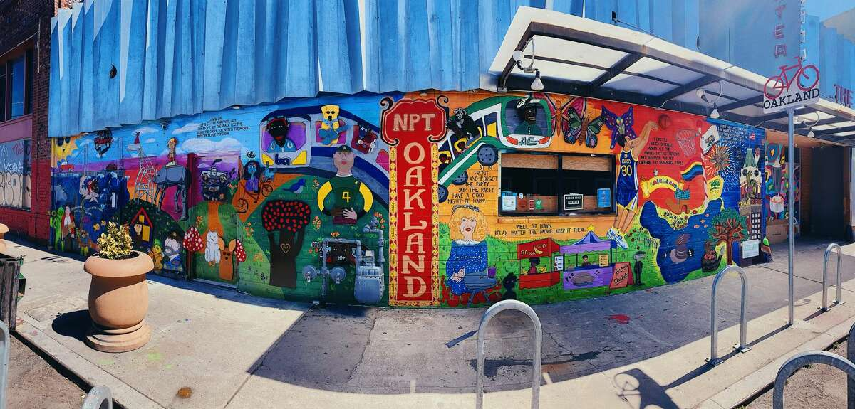 A new mural in front of the New Parkway Theater in Oakland.