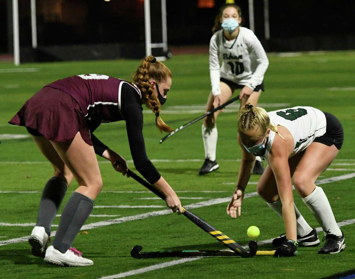 Shen's Hannah Merritt stops a ball tapped by Burnt Hills's Isabelle Adams during a game on Wednesday, Oct. 28, 2020, at Shenendehowa High School in Clifton Park, N.Y. (Jenn March, Special to the Times Union)