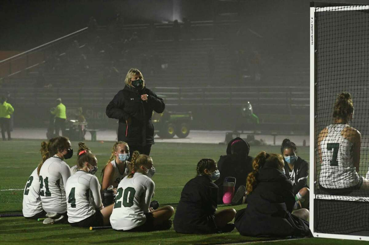 Shen varsity field hockey coach Jeanne Frevola instructs her players between halves of a game against Burnt Hills on Wednesday, Oct. 28, 2020, at Shenendehowa High School in Clifton Park, N.Y. (Jenn March, Special to the Times Union)