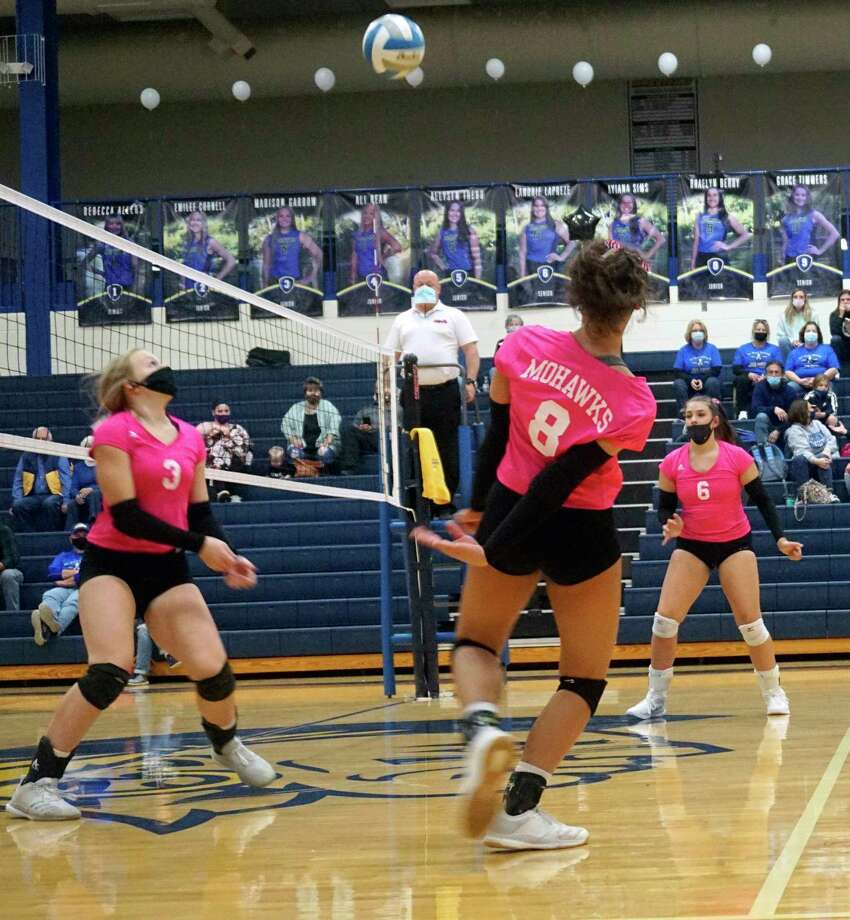 Braelyn Berry, Madison Garbow and Landrie LaPreze defend a shot during the second set of Morley Stanwood's victory over Lakeview on Wednesday night. (Pioneer photo/Joe Judd)