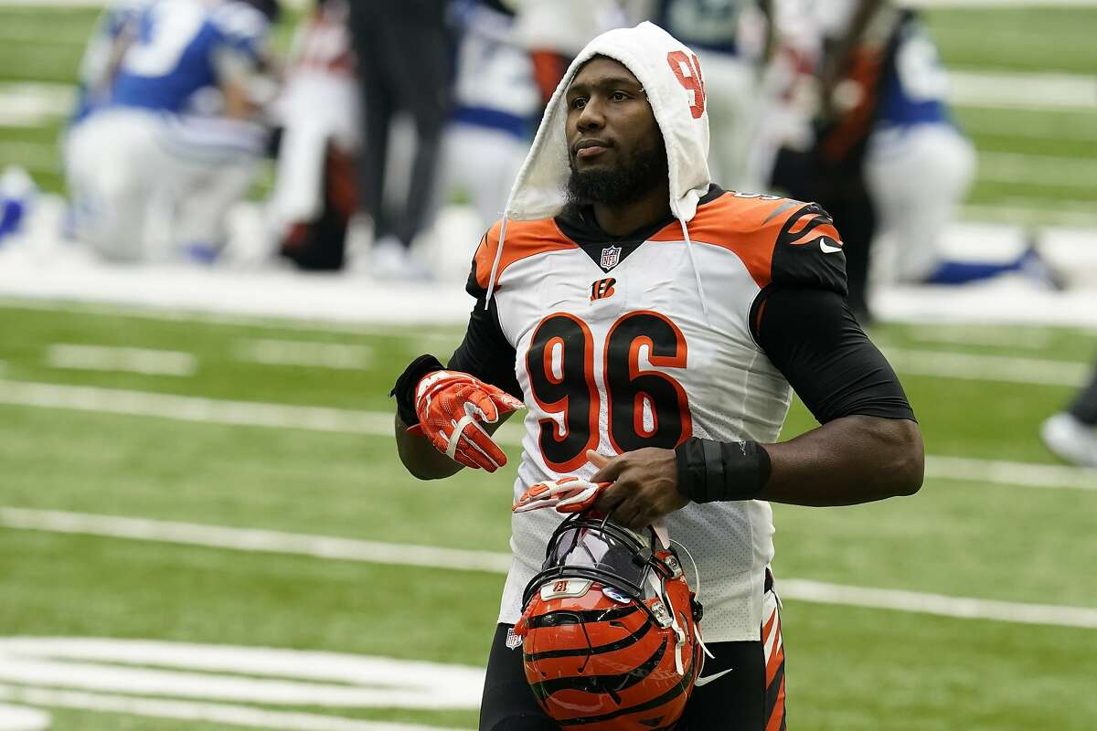 Defensive end Carlos Dunlap played seven games with the Bengals and eight with the Seahawks last season.