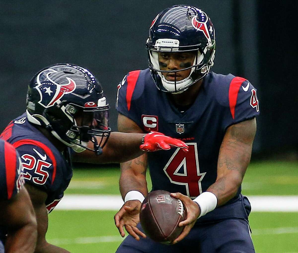Quarterback Deshaun Watson (4) hasn't seen the greatest results after handing off to the Texans' running backs, Duke Johnson included.