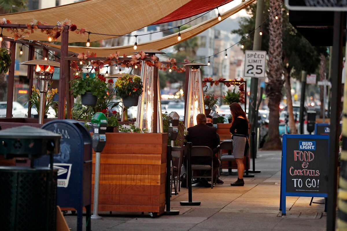 Owner Shirley Tan talks with diners at the Bottoms Up Bar and Lounge's parklet on Mission Street.