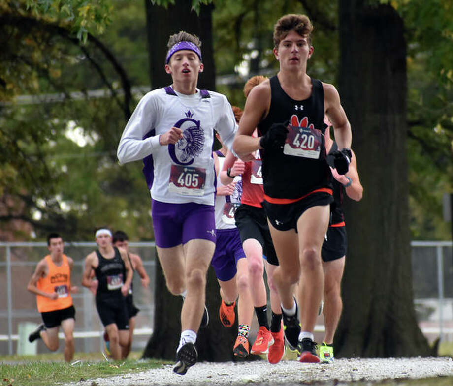 Edwardsville's Ryan Luitjohan leads a pack of runners down a rock trail during the Class 3A Granite City Regional. Photo: Matt Kamp|The Intelligencer