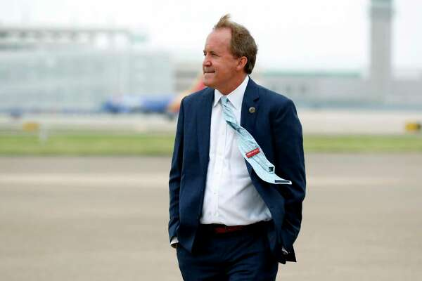 FILE - In this June 28, 2020 file photo, Texas State's Attorney General Ken Paxton waits on the flight line for the arrival of Vice President Mike Pence at Love Field in Dallas. Paxton is facing calls for his resignation and accusations of crimes by his own staff over an investigation sought by one of the Republican's wealthy donors. (AP Photo/Tony Gutierrez File)