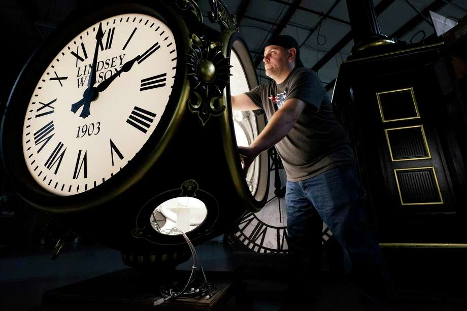 Dan LaMoore works on a Seth Thomas Post Clock at Electric Time Company, Friday, Oct. 23, 2020, in Medfield, Mass. Photo: Elise Amendola / Associated Press / Copyright 2020 The Associated Press. All rights reserved.