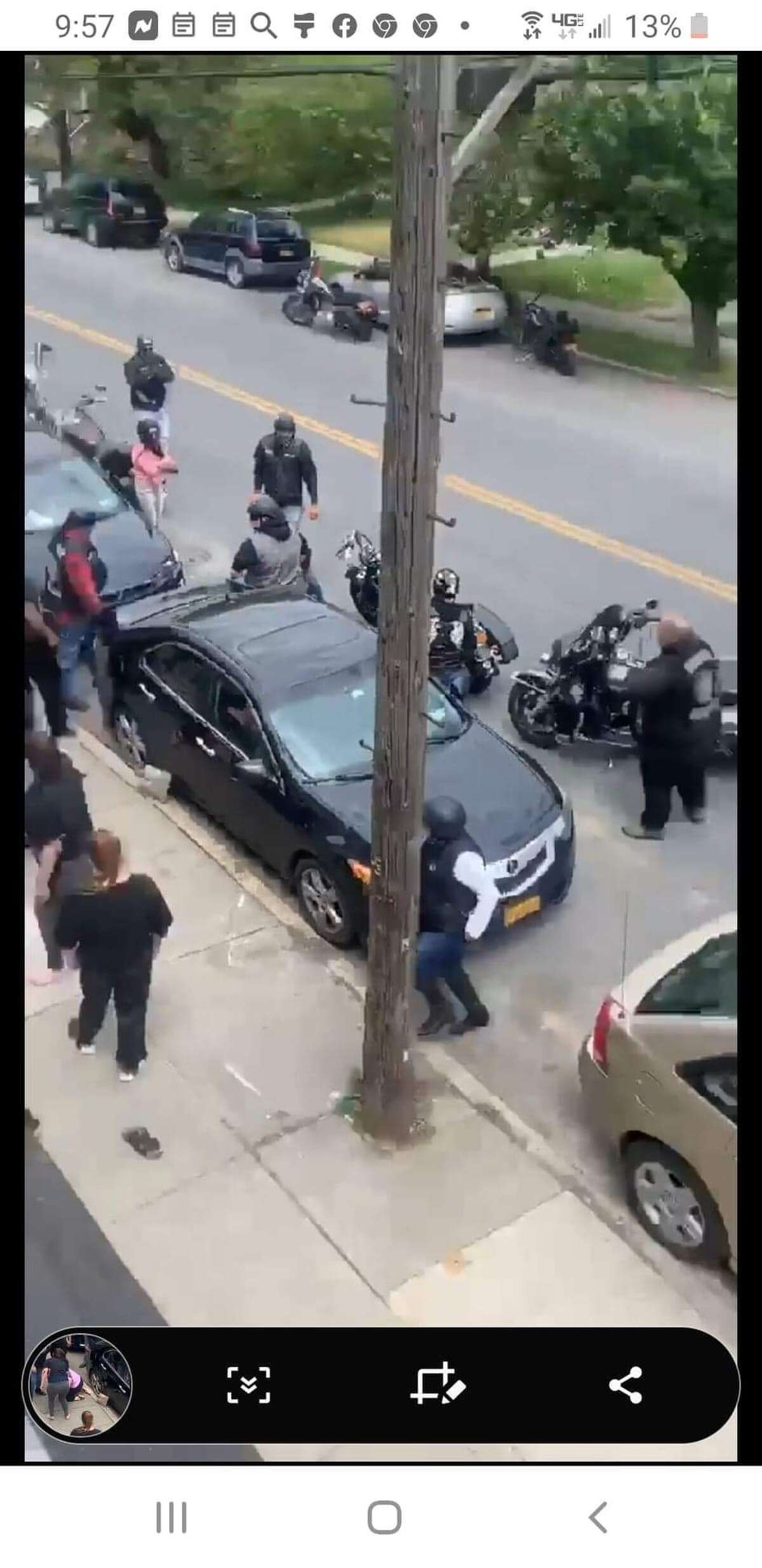 Joseph P. Brady, a longtime legislative aide to a Brooklyn assemblyman, is pictured at right in this undated photo, his arms crossed, as members of his motorcycle club, East Coast Syndicate, are involved in a brawl on a Troy street. (Provided photo)
