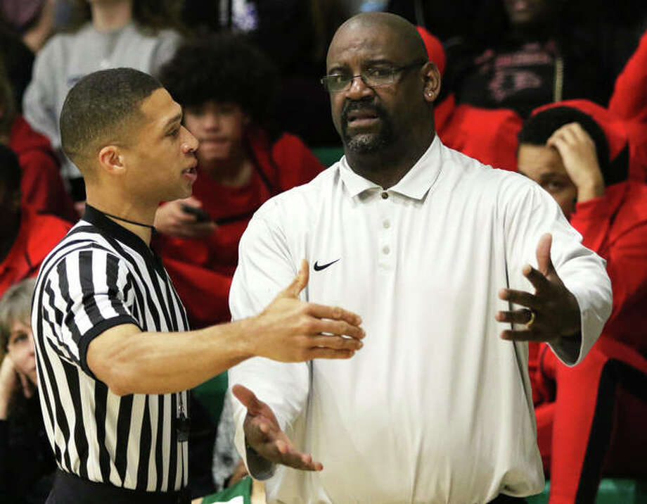 Metro-East Lutheran coach Anthony Smith gets an explanation for a call from an official last season during the MELHS Turkey Tipoff. Photo: Matt Kamp/The Intelligencer