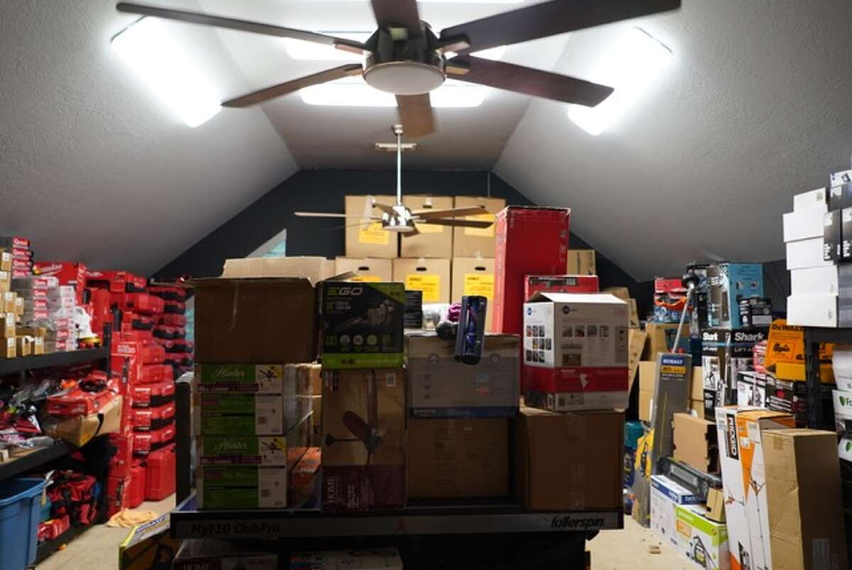 Police tracked a trailer of stolen goods to the home in Katy, which was filled with items worth more than $1 million such as lawn equipment, hardware, tools and light fixtures.