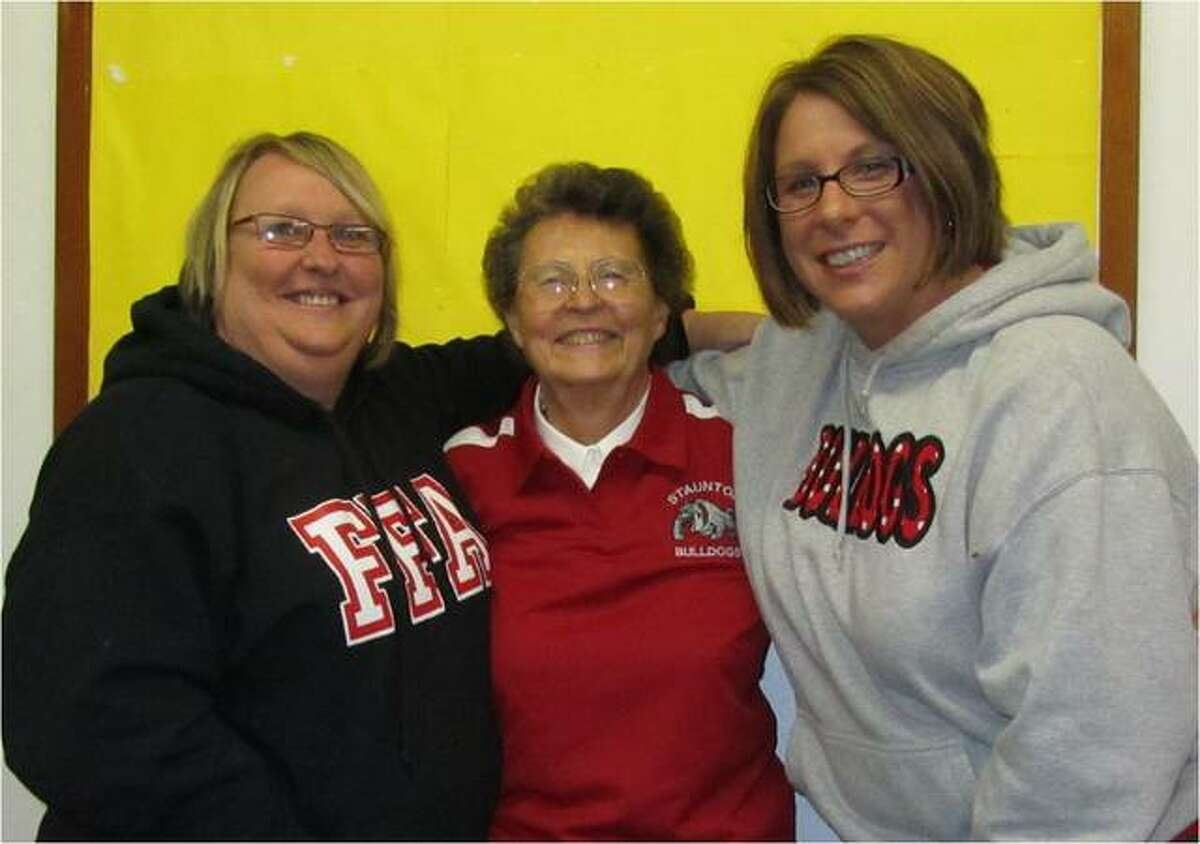 Patricia Long, center, is shown with Tami Allen Johnston, left, and Katie Johnson Biama. Johnston is a special education teacher and Biama teaches English. Both were students of Long's in high school.