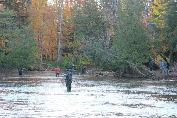 While not as numerous as when the salmon run started in August, anglers are still trying to catch the stragglers in October. (Photo/Colin Merry)