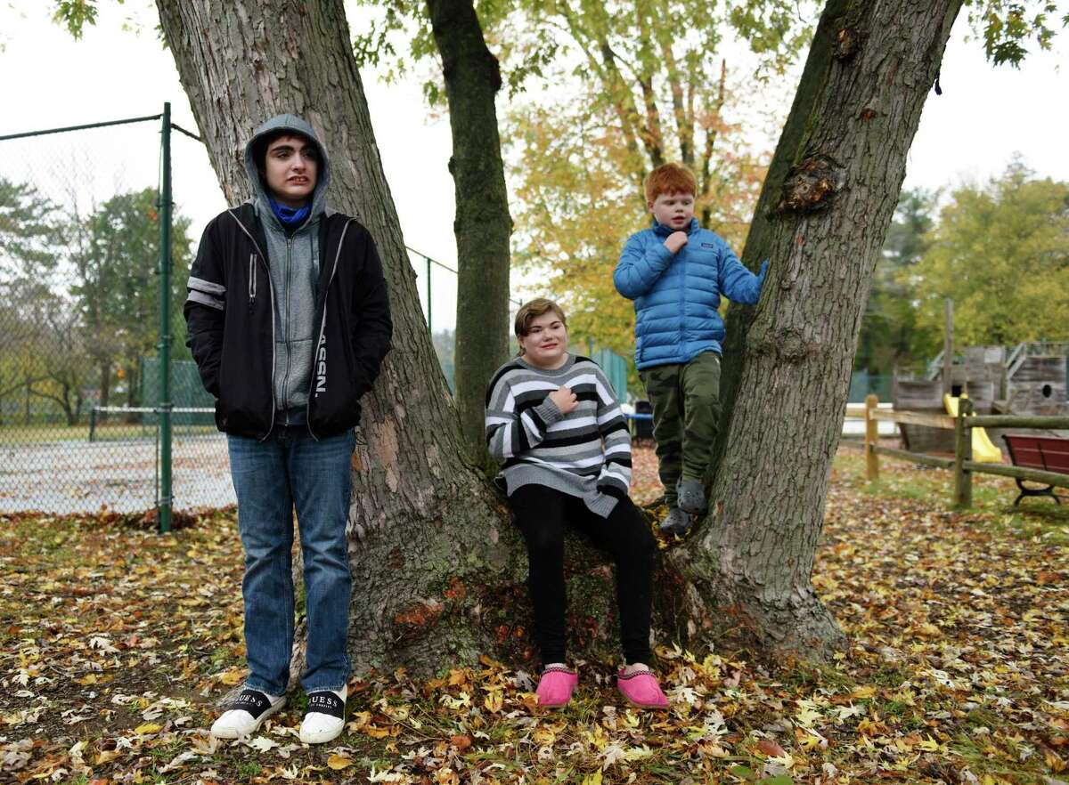 Hubbard Day School students Giovanni Nozzolini, 16, of Colchester, Sydney Iannuzzi, 14, of Wilton, and Max Garan, 9, of Greenwich, pose outside Hubbard Day School in Greenwich, Conn., photographed on Monday, Oct. 26, 2020.