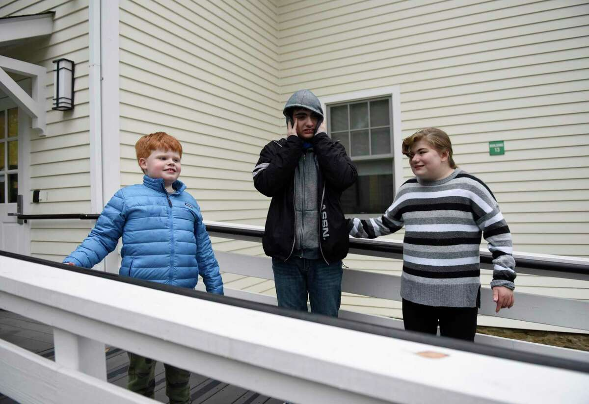 Hubbard Day School students Max Garan, 9, of Greenwich, Giovanni Nozzolini, 16, of Colchester, and Sydney Iannuzzi, 14, of Wilton, pose outside Hubbard Day School in Greenwich, Conn., photographed on Monday, Oct. 26, 2020.