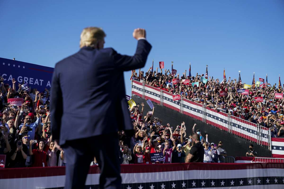 President Trump during a campaign rally in Goodyear, Ariz., on Oct. 28, 2020. Trump's enduring appeal also was abundantly evident in the final weeks of the campaign, when the Republican once again attracted massive, adoring crowds in obscure places like Goodyear, Ariz., shown here. Even the pandemic failed to keep his supporters away. (Washington Post photo by Jabin Botsford.)