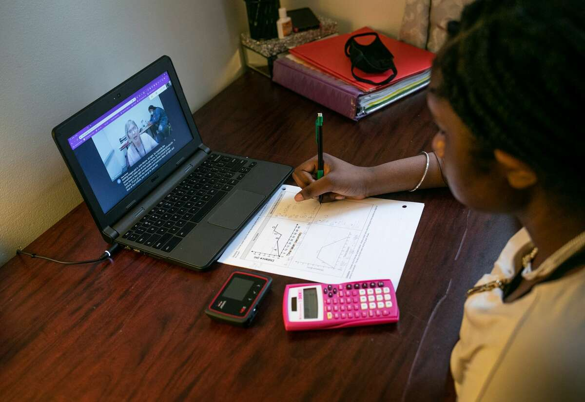 Abigail Previlon, 13, takes part in remote distance learning with her deaf education teacher Diane Gamse on October 28, 2020 in Stamford, Connecticut.