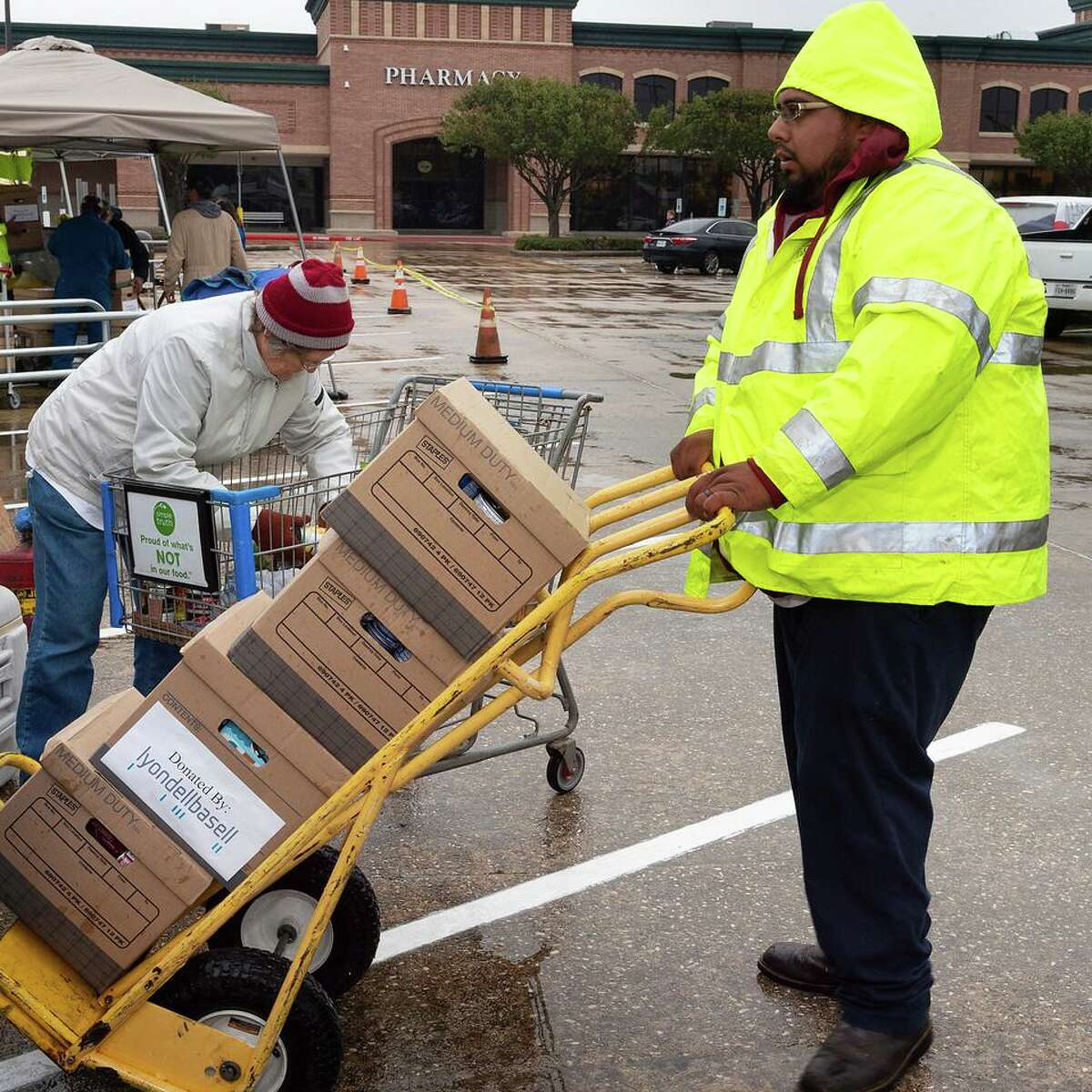 Volunteers work during a previous food drive by the city of Pasadena. This year's event will occur in the shadow of the coronavirus pandemic, which is affecting many local families, organizers say.