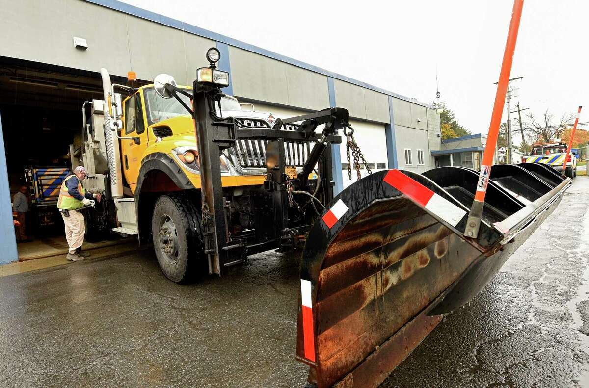 Department of Transportation workers get snowplows ready for potential snow expected early tomorrow morning Thursday, Oct. 29, 2020 in Latham, N.Y. (Lori Van Buren/Times Union)