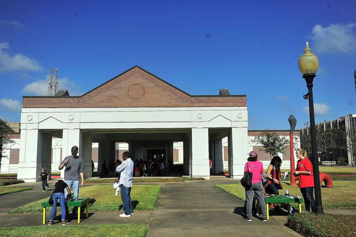 Families make their way through the outdoor activities during the Art Museum of Southeast Texas' annual