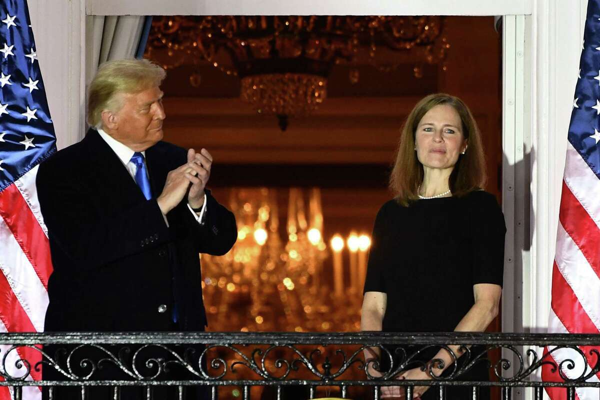 President Donald Trump applauds Justice Amy Coney Barrett