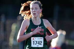 The Woodlands' Natasja Beijen finished first overall in the District 13-6A high school cross country championship at College Park High School, Thursday, Oct. 29, 2020, in The Woodlands