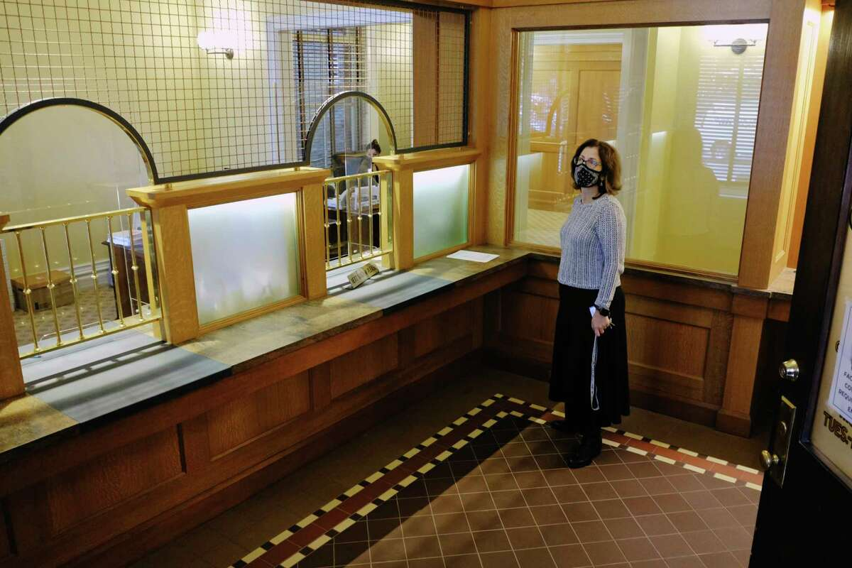 Saratoga Springs Commissioner of Finance Michele Madigan in the public area of the finance office during of tour of City Hall and the finished renovations on Thursday, Oct. 29, 2020, in Saratoga Springs, N.Y. This is the window area inside where residents can come to pay their tax or utilities bill. (Paul Buckowski/Times Union)