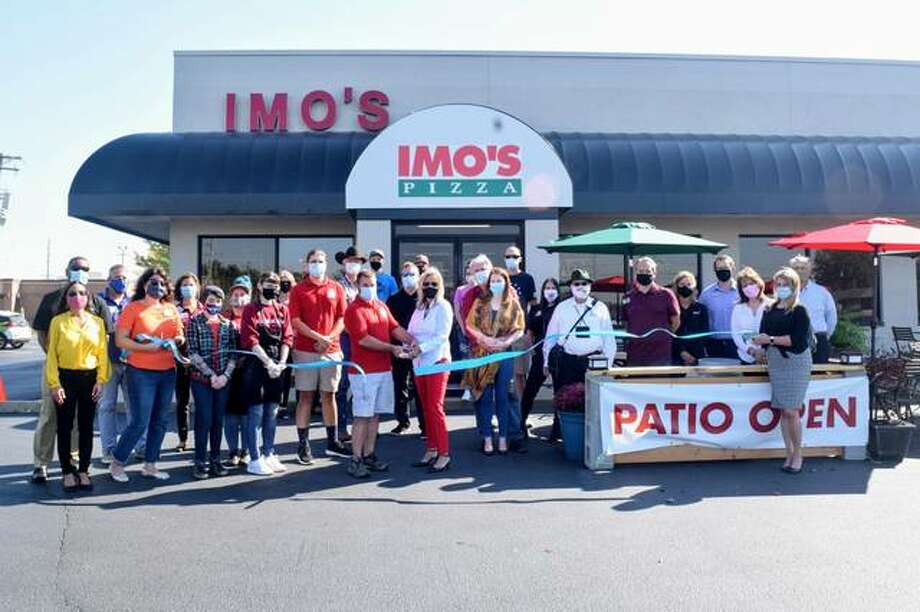 Lori Bromberg owner of Imo's pizza and is featured in the center. Photo: Courtesy Of Ed/Glen Chamber Of Commerce