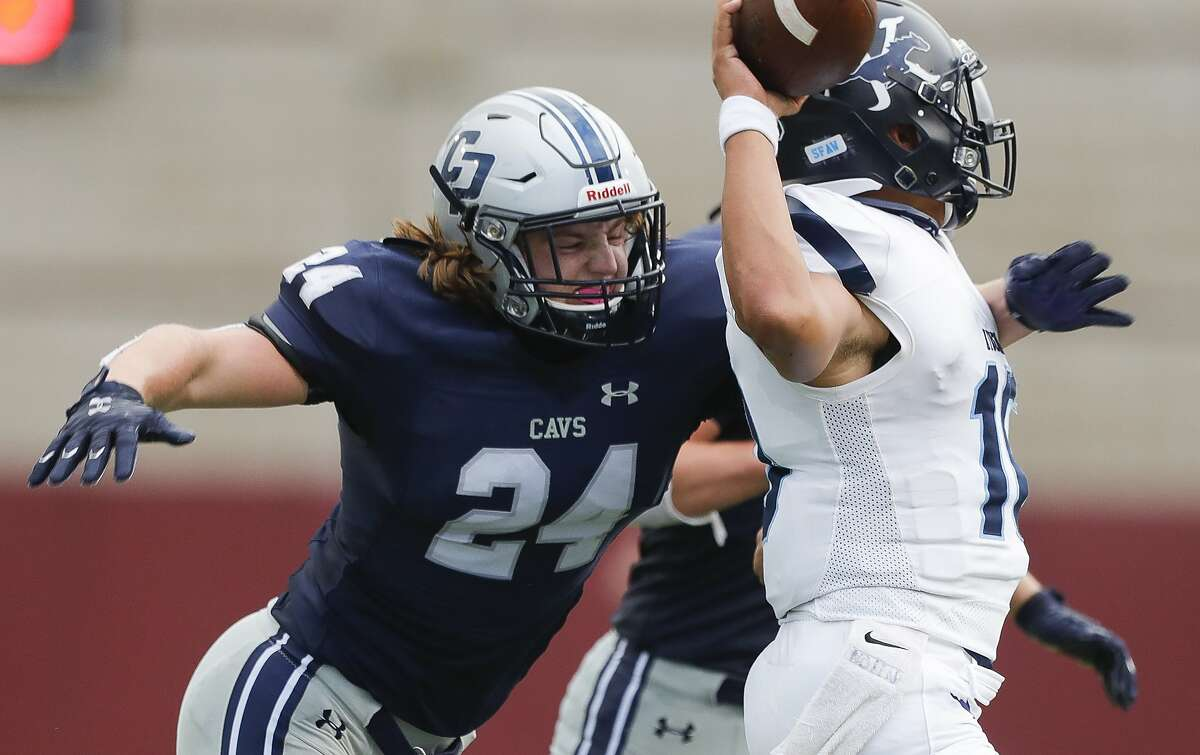 College Park linebacker Dylan Hazen (24) pressures Kingwood quarterback Jonathan Mendoza (10) during the third quarter of a non-district high school football game at Woodforest Bank Stadium, Saturday, Oct. 17, 2020, in Shenandoah.