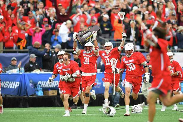 The Wesleyan men's lacrosse team defeated Salisbury 8-6 at Gillette Stadium in Foxborough, Mass. to win its first national championship in 2018.