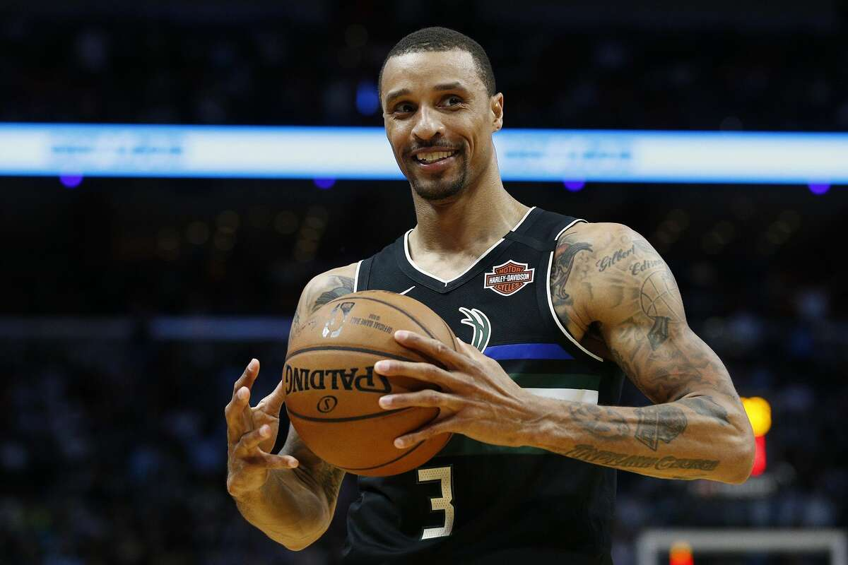 MIAMI, FLORIDA - MARCH 02: George Hill #3 of the Milwaukee Bucks reacts against the Miami Heat during the first half at American Airlines Arena on March 02, 2020 in Miami, Florida. NOTE TO USER: User expressly acknowledges and agrees that, by downloading and/or using this photograph, user is consenting to the terms and conditions of the Getty Images License Agreement. (Photo by Michael Reaves/Getty Images)