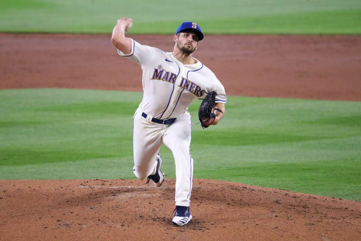 SEATTLE, WASHINGTON - AUGUST 02: Kendall Graveman #49 of the Seattle Mariners pitches in the second inning against the Oakland Athletics during their game at T-Mobile Park on August 02, 2020 in Seattle, Washington. (Photo by Abbie Parr/Getty Images)