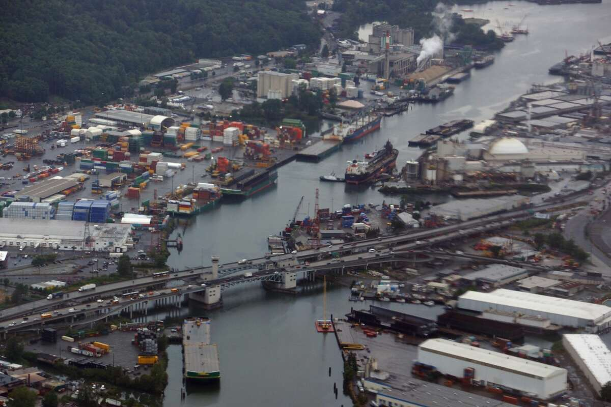 Seattle - June 24, 2016: Aerial view of First Avenue South Bridge and Duwamish Waterway. The First Avenue South Bridge is a pair of double-leaf bascule bridges built between 1956 and 1998 that carry State Route 99 over the Duwamish River about three miles (5 km) south of downtown Seattle, Washington. The northbound span was built in 1956 to connect the industrial areas northeast of the Duwamish to the residential neighborhoods to the south and southwest. Between 1996 and 1998, the drawspan was retrofitted and the approaches completely demolished and rebuilt. The southbound span opened in February 1997 and carried traffic in both directions for two years while the northbound span was rebuilt.