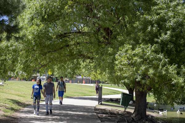Walkers stroll around Wadley Barron Park on June 6, 2019. Studies have shown that residents are happy with their city if they have opportunities for chance encounters - such as might occur at a local park.