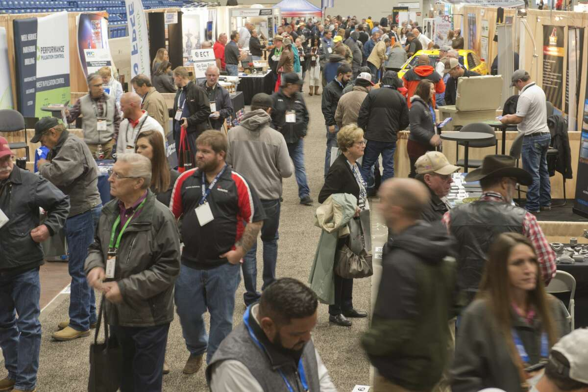 A crowd wanders through the indoor booths set up inside Ector County Coliseum Oct. 16, 2018, for the Permian Basin International Oil Show.