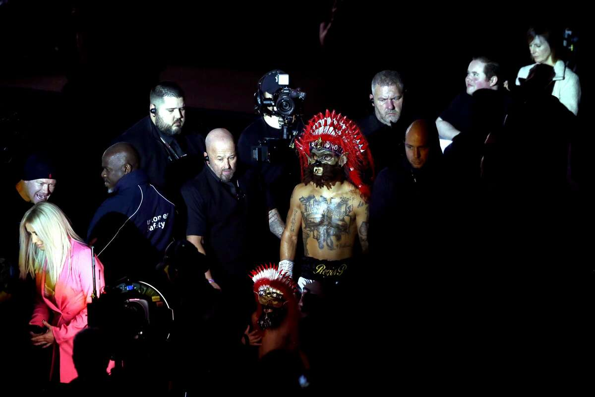 Regis Prograis enters the ring with the mask of the Rougarou, a mythical creature in Cajun lore.