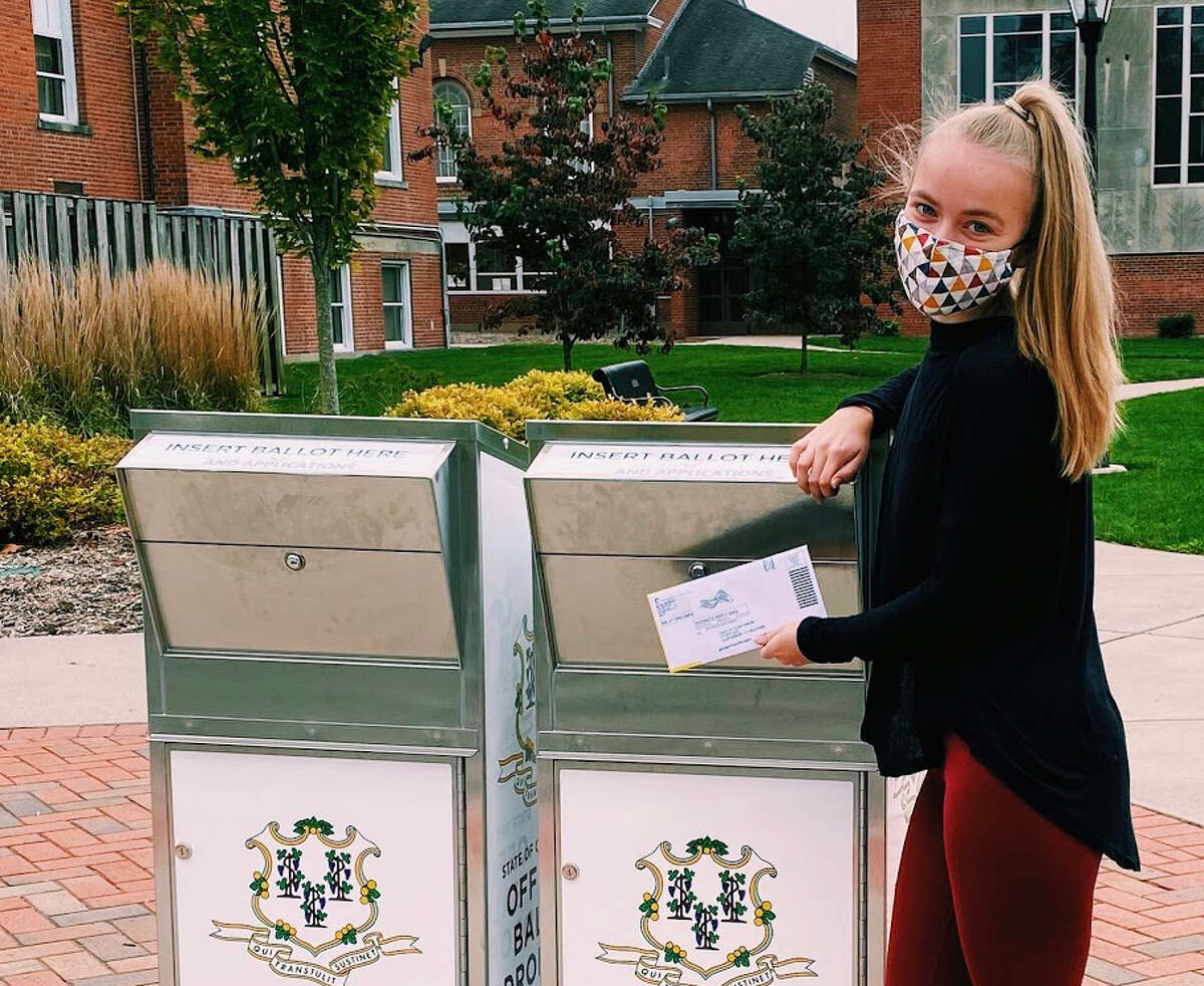 Sunny Sanderson from Glastonbury votes for her first time via an absentee ballot. Sunny Sanderson, 18, Glastonbury Sanderson, who was not old enough to vote before 2020, is thrilled to have voted for the first time this year.