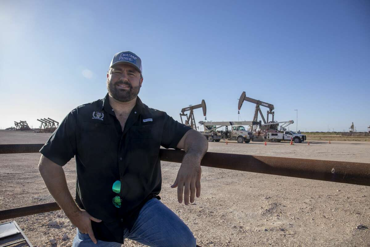 Independent landman Chance Freeman, standing along Tradewinds Boulevard, owns Havasu Energy. Despite the uncertainty surrounding the oil and gas business, he said he plans to stick it out.