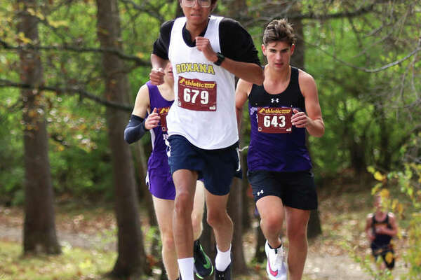 Roxana senior Carlos Ruvalcaba (front) leads runners out of the woods at Loveless Park during the Carlinville Class 1A Regional last Saturday. Ruvalcaba placed second in the race and joins his Shells teammates Saturday in the Decatur St. Teresa Sectional at Hickory Point golf course in Forsyth.