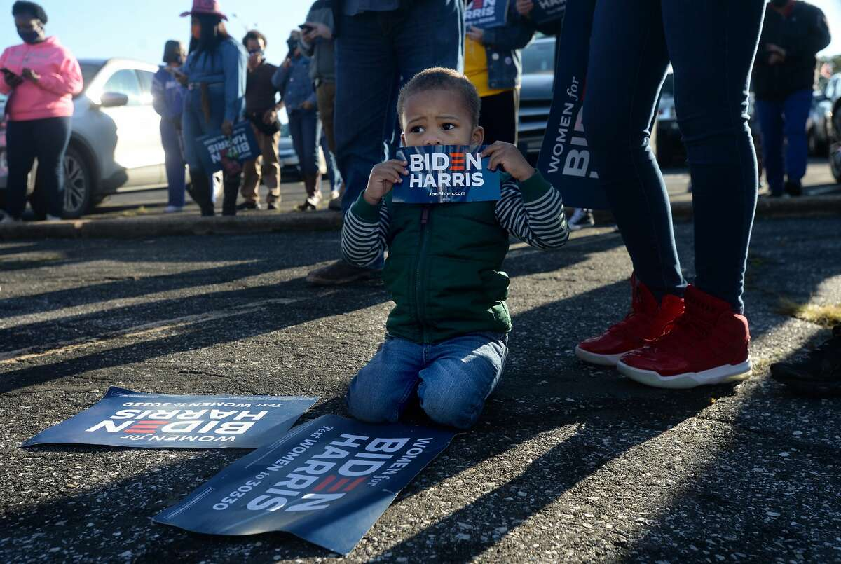 King Graceson, 2, sits among signs while he and family join in the Biden/Harris bus rally in Beaumont early Thursday morning. Several joined the caravan following the bus for a rally stop in Port Arthur. Photo taken Thursday, October 29, 2020 Kim Brent/The Enterprise