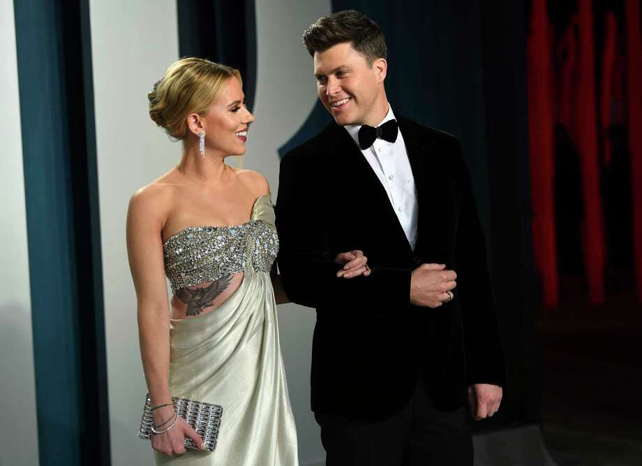 FILE - In this Feb. 9, 2020 file photo, Scarlett Johansson, left, and Colin Jost arrive at the Vanity Fair Oscar Party in Beverly Hills, Calif.  Meals on Wheels America announced Thursday on Instagram that Johansson and Jost married over the weekend in an intimate ceremony. (Photo by Evan Agostini/Invision/AP, FIle) Photo: Evan Agostini, Evan Agostini/Invision/AP / 2020 Invision