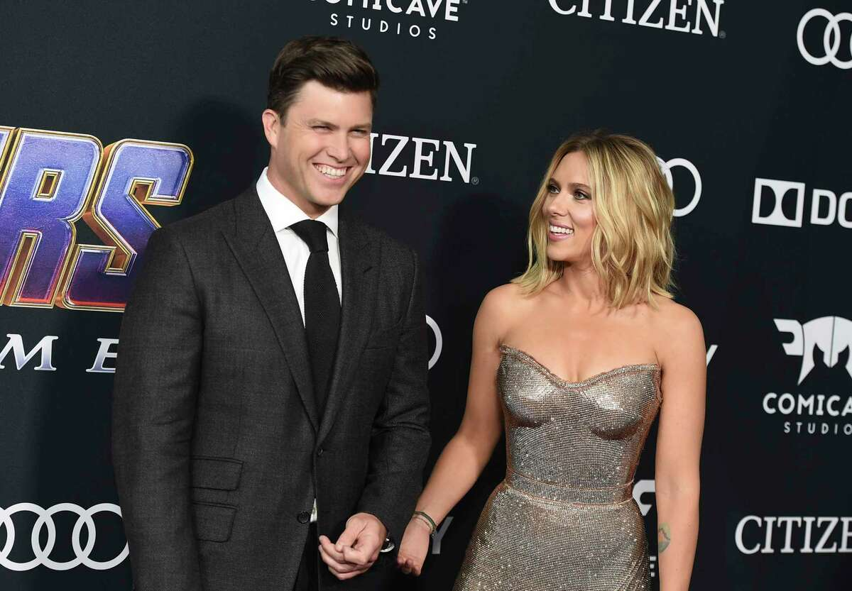 """FILE - In this April 22, 2019 file photo, Colin Jost, left, and Scarlett Johansson arrive at the premiere of """"Avengers: Endgame"""" in Los Angeles. Meals on Wheels America announced Thursday on Instagram that Johansson and Jost married over the weekend in an intimate ceremony. (Photo by Jordan Strauss/Invision/AP, File)"""