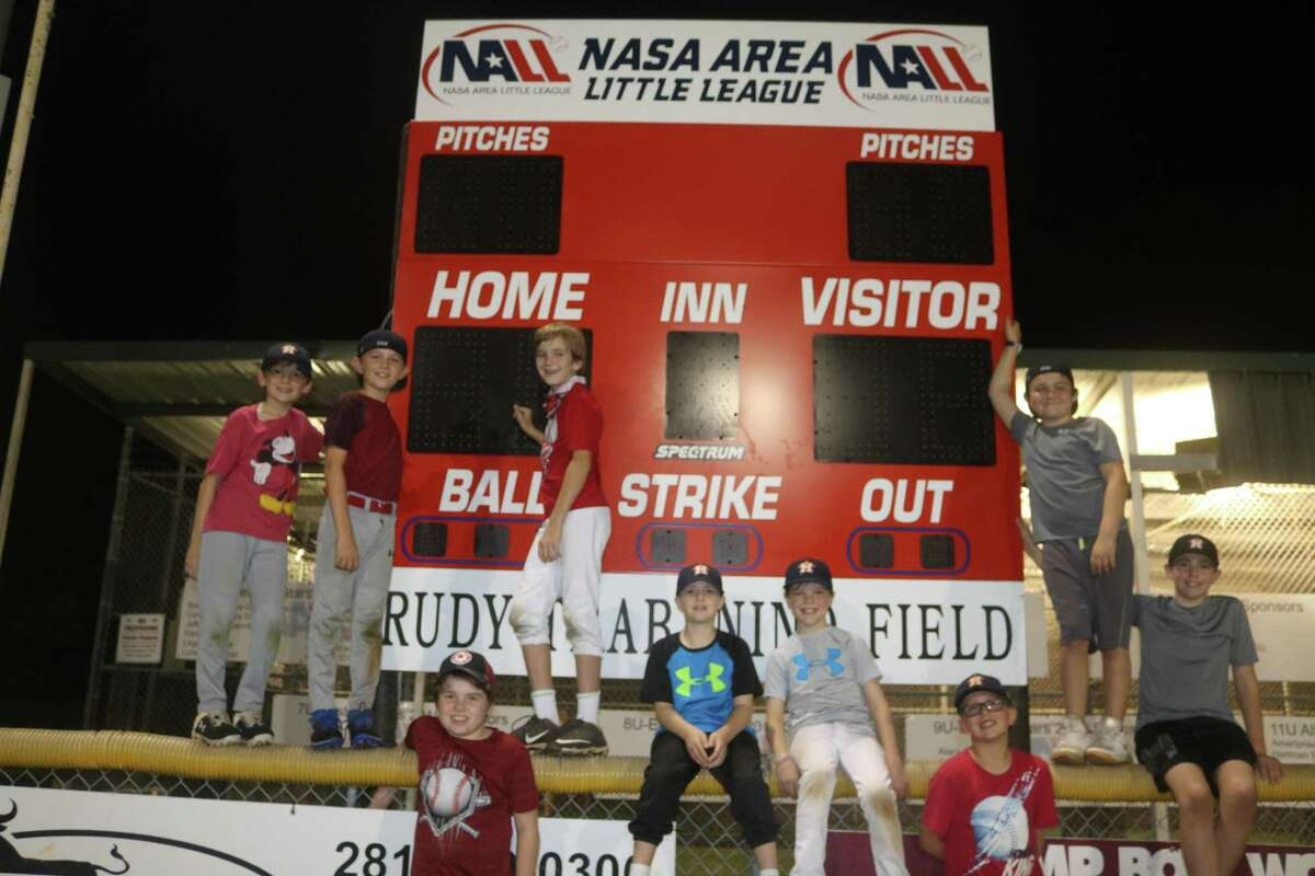 The NASA Area Little League fall-ball Astros are excited about the league's new scoreboard, which features pitch-count windows. Because the old scoreboard had to use incandescent bulbs that constantly burned out, scores were previously hard to read.