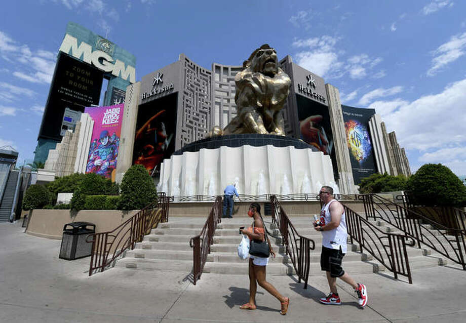Visitors walk in front of MGM Grand Hotel & Casino on the Las Vegas Strip on Aug. 28.