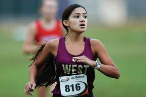 Magnolia West's Catherine Benavidez finished second overall at the District 19-5A championships Thursday morning.