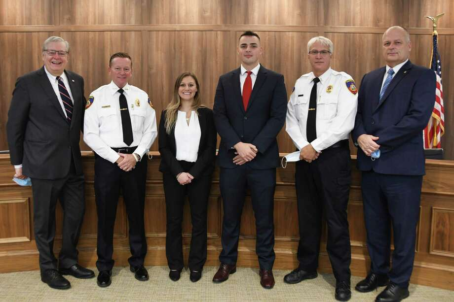 New police cadets, middle, Alesis Spinconardi, 22, and Ferris Korenic, 23, with, from left: Mayor David Martin, Police Chief Tim Shaw, Assistant Chief Tom Wuennemann and Public Safety Director Ted Jankowski at a swearing in ceremony for the cadets on Wednesday, Oct. 28, 2020. Photo: Ed Rondano / Contributed