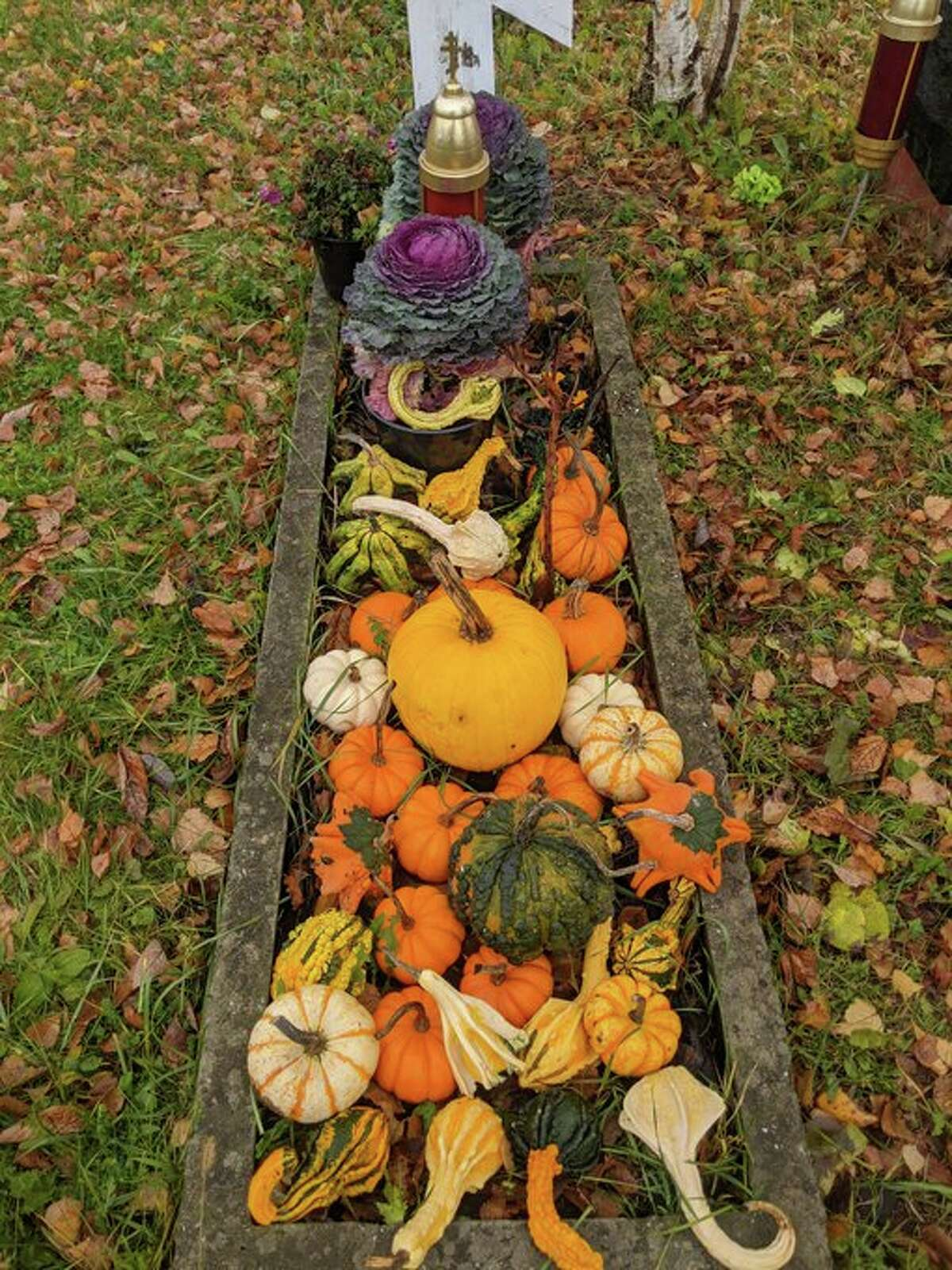 The distinctive Russian Orthodox crosses are at the head of each grave. Some are wood and some are stone. The cemetery is in the middle of beautiful farmland, down the road from the cathedral and monastery. Many graves had seasonal adornments such as gourds, pumpkins, winter cabbage and colorful leaves.