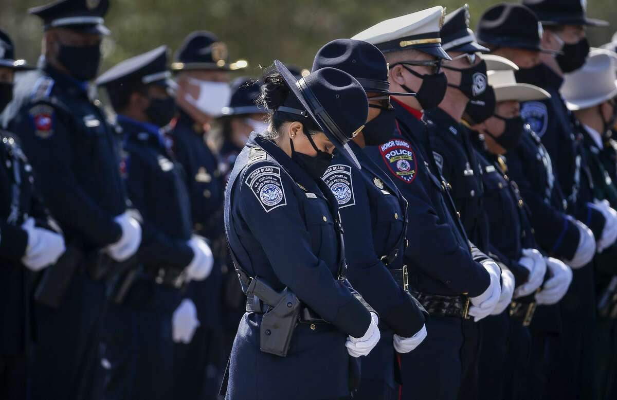 A member of the U.S. Customs and Border Protection Honor Guard bows her head during the funeral service for Houston Police sergeant Harold Preston on Thursday, Oct. 29, 2020, at Grace Church in Houston.